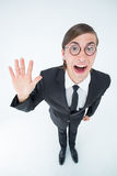 Geeky businessman waving at camera Stock Image