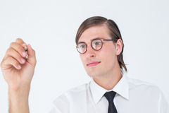 Geeky businessman writing with pen Royalty Free Stock Images