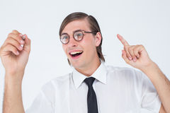 Geeky businessman writing with pen Royalty Free Stock Photography