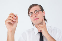 Geeky businessman writing with pen Royalty Free Stock Photos