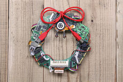 Geeky christmas wreath made by old computer parts. Hanging on wooden door, computer parts recycling idea Stock Photos