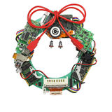Geeky christmas wreath made by old computer parts, no shadow. Geeky christmas wreath made by old computer parts isolated on white background, no shadow Stock Photo