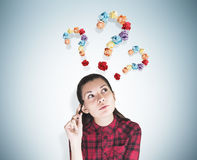 Geeky girl and three question marks Royalty Free Stock Photo