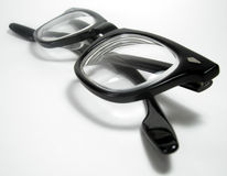Geeky Glasses. A pair of bifocals with thick, black plastic frames Stock Image