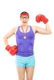 Geeky guy with boxing gloves wearing a medal Royalty Free Stock Photos