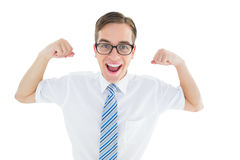 Geeky happy businessman flexing biceps Stock Photo