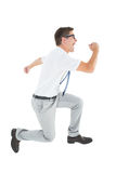 Geeky happy businessman running mid air Royalty Free Stock Photography
