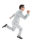 Geeky happy businessman running mid air Royalty Free Stock Images