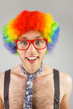 Geeky hipster in afro rainbow wig. On grey background Royalty Free Stock Image