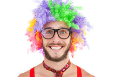 Geeky hipster in afro rainbow wig. On white background Stock Image