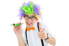 Geeky hipster in afro rainbow wig. On white background Stock Images