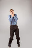 Geeky hipster biting his nails Royalty Free Stock Photography