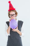 Geeky hipster blowing up balloon Stock Photography