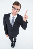 Geeky hipster businessman with finger up Stock Photo
