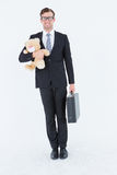 Geeky hipster businessman holding briefcase and teddy Stock Photo