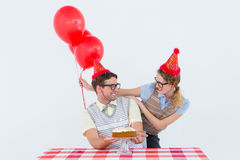 Geeky hipster couple celebrating his birthday Royalty Free Stock Images