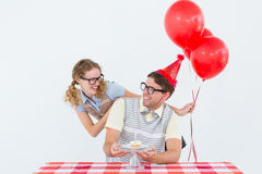 Geeky hipster couple celebrating his birthday Royalty Free Stock Photo