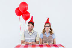 Geeky hipster couple celebrating his birthday Royalty Free Stock Photos