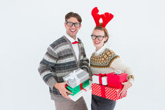 Geeky hipster couple holding presents Stock Photography