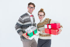 Geeky hipster couple holding presents Stock Photos