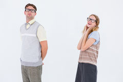 Geeky hipster couple looking at camera Royalty Free Stock Photo