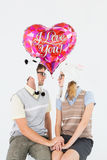 Geeky hipster couple looking to each other Royalty Free Stock Photography