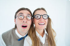 Geeky hipster couple raising eyes Stock Images