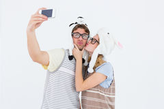 Geeky hipster couple taking selfie with smartphone Royalty Free Stock Photos