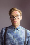 Geeky hipster covered in kisses Royalty Free Stock Photo