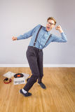 Geeky hipster dancing to vinyl Stock Photo