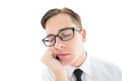 Geeky hipster falling asleep on hand Royalty Free Stock Photos