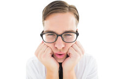 Geeky hipster falling asleep on hands Royalty Free Stock Image