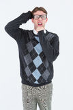 Geeky hipster frowning at camera Stock Photography