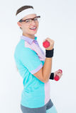 Geeky hipster girl lifting dumbbells Royalty Free Stock Image