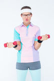 Geeky hipster girl lifting dumbbells Stock Images