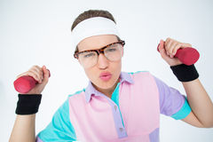 Geeky hipster girl lifting dumbbells Stock Photography