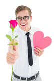 Geeky hipster holding a red rose and heart card Stock Image
