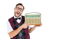 Geeky hipster holding a retro radio Royalty Free Stock Image