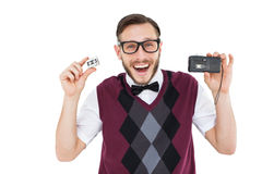 Geeky hipster holding a retro tape cassette player Stock Images