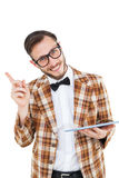Geeky hipster holding a tablet pc royalty free stock photos