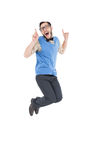 Geeky hipster jumping and smiling Royalty Free Stock Image