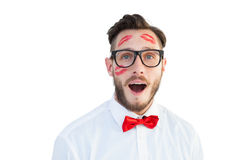 Geeky hipster with kisses on his face Stock Image
