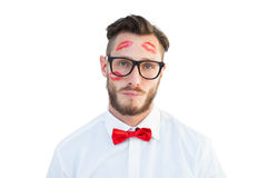 Geeky hipster with kisses on his face Stock Photo