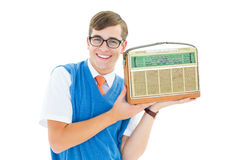 Geeky hipster listening to retro radio Stock Image