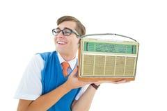 Geeky hipster listening to retro radio Stock Photos