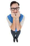 Geeky hipster looking nervously at camera Royalty Free Stock Photos