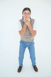 Geeky hipster looking nervously at camera Stock Photos