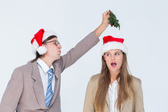Geeky hipster with mistletoe Stock Photo