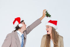 Geeky hipster with mistletoe Stock Image