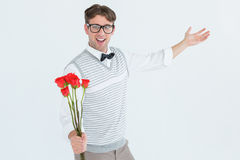Geeky hipster offering bunch of roses Stock Photography